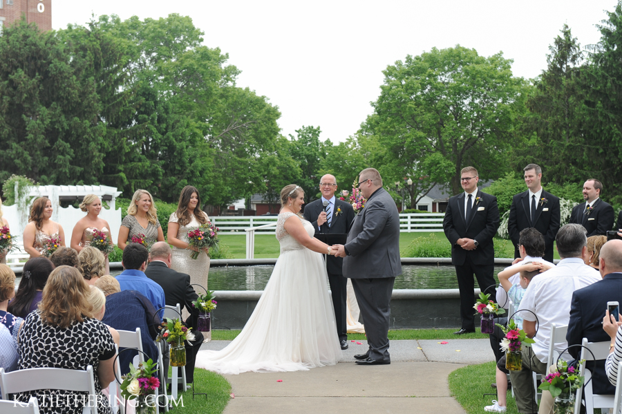Wedding Vows in front of fountain at Earle Brown Heritage Center