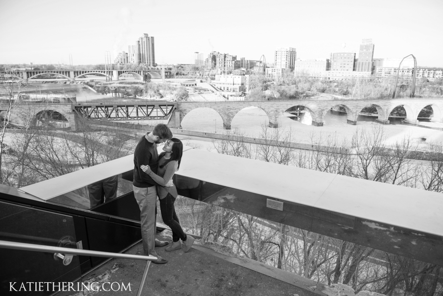 Engagement photo at the Guthrie Theater with view of Stone Arch Bridge